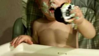 Brayden eating his 1st Birthday cupcake