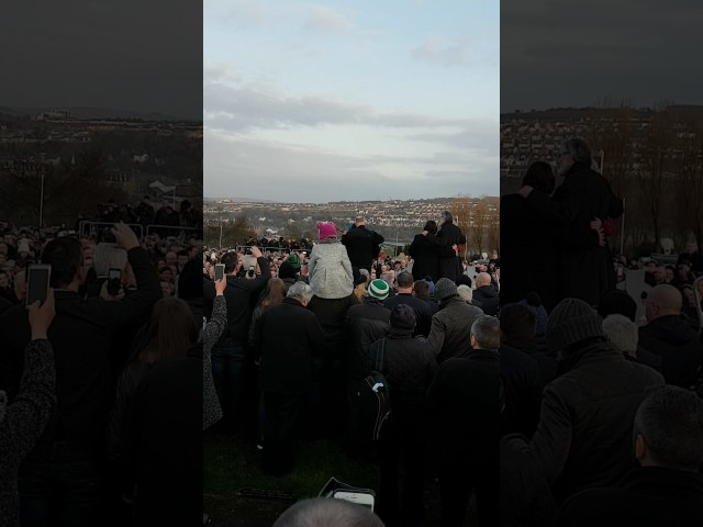 Christy Moore sings at the grave of Martin McGuinness