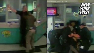 Prison fight breaks out between a deputy and a jailer