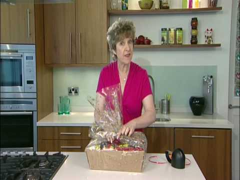 Wrapping a hamper using cellophane wrap