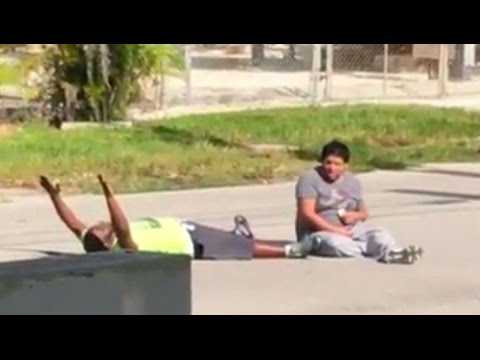 Unarmed Black Man Lying In The Street With Hands Up Gets Shot By Police