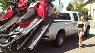load and unload 2 snowmobiles into the back of your truck the easy way