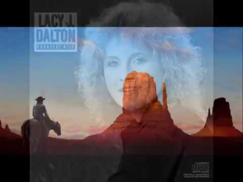 Slow Movin' Outlaw by Willie Nelson and Lacy J. Dalton