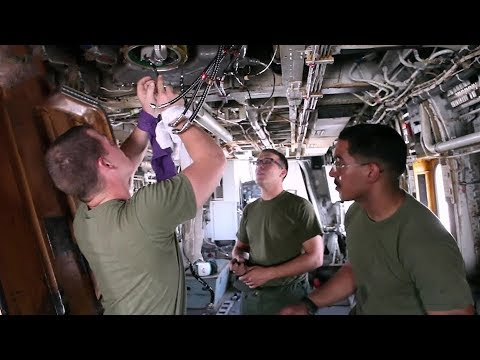 Marine Corps Avionic Technicians Working On CH-53E Super Stallion Helicopter