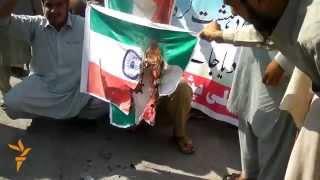 Pakistanis Burn Indian Flag After Border Shooting
