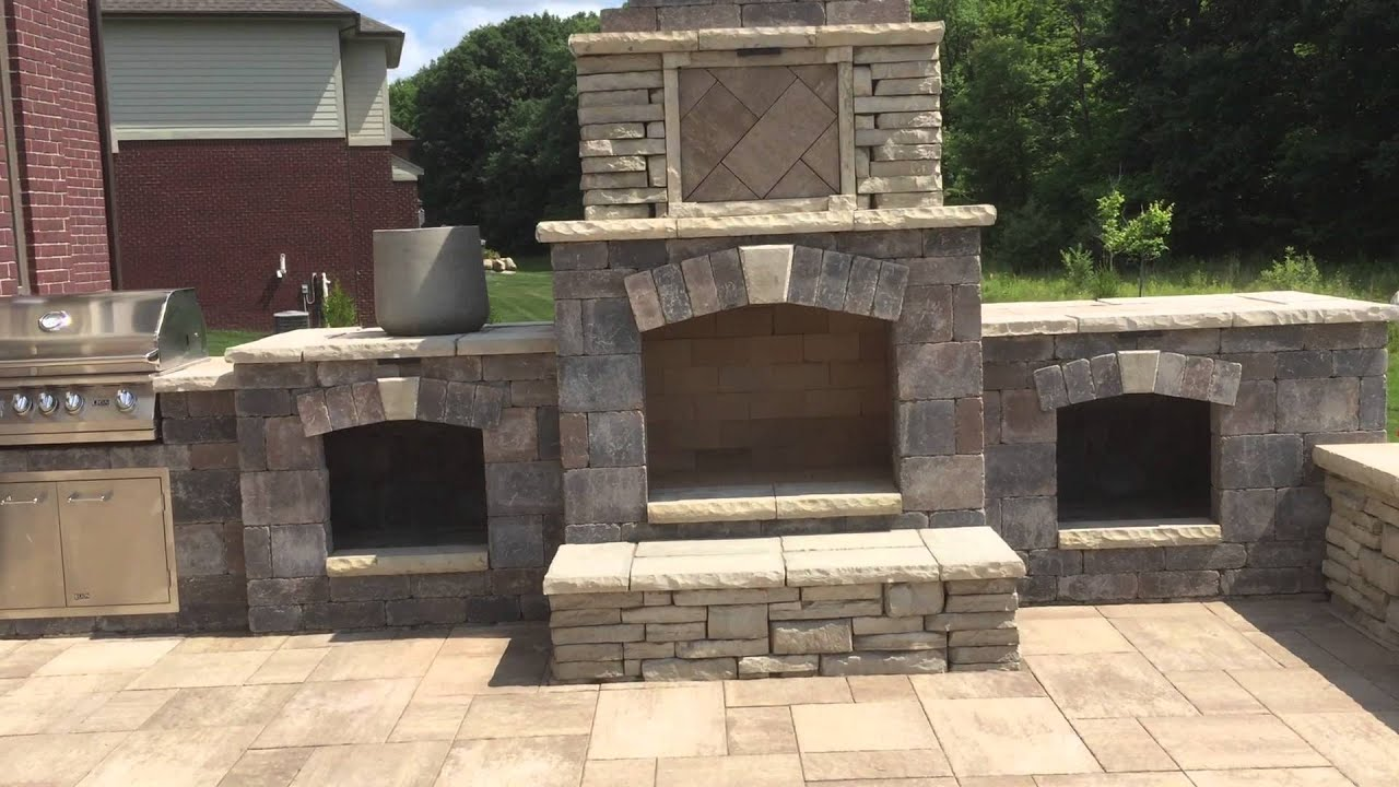 custom raised brick patio with a custom outdoor fireplace oakland