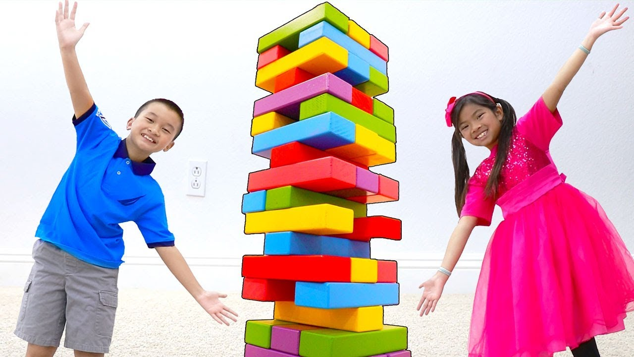 Emma & Andrew Pretend Play with Giant Colored Jenga Toy Blocks