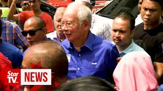 Tanjung Piai: Cheers and jeers for Najib during polling centre visit