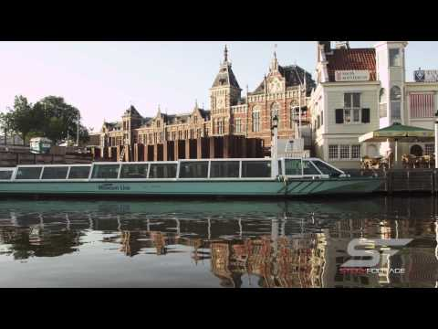 Tracking shot of buildings at the waterfront on 2013 in Amsterdam, Netherlands