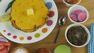 Tilt shot - Punjabi Thali With freshly made Makki Ki Roti rotating on a turntable