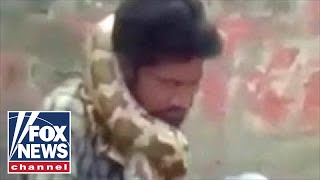 WILD video: Snake charmer strangled by python