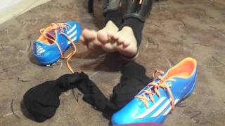 Taking off my new soccer boots and socks