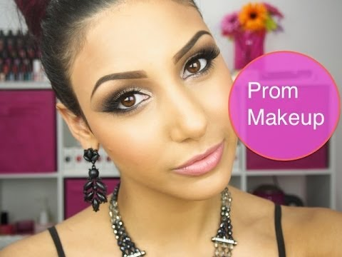 Prom makeup with black hair and yellow dress.