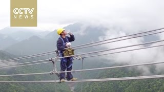 Men on wire Power workers walk in the clouds to repair lines