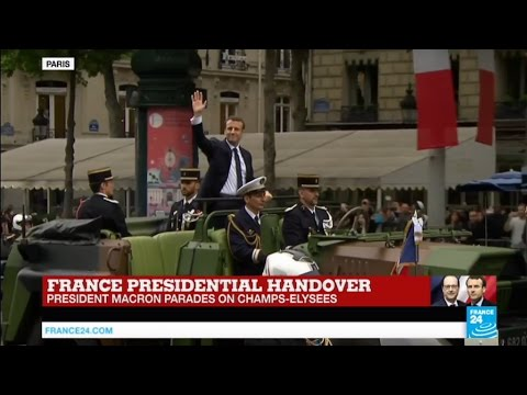 French President Emmanuel Macron parades on Champs-Elysées Avenue