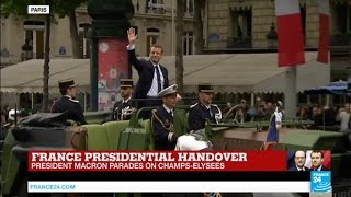 French President Emmanuel Macron parades on Champs Elysées Avenue