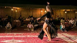 Exotic belly dancing in Dubai desert...