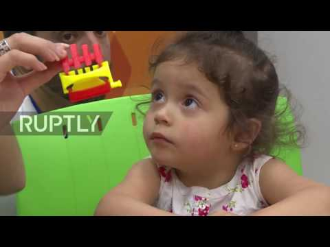 Uruguay: Children delight as they receive 3D-printed prosthetic hands