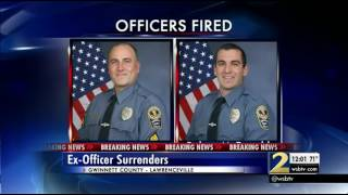 One of two former officers in videotaped beating surrenders