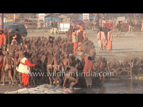 Naga Sadhus run into the sacred Ganges River to wash sins - Kumbh Mela