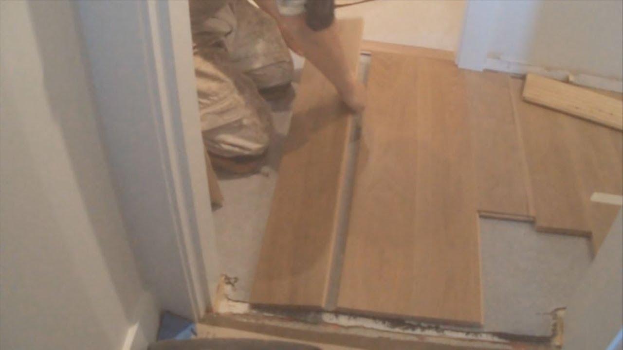 How to installing a hardwood floor glue down between two rooms in how to installing a hardwood floor glue down between two rooms in a hallway mryoucandoityourself youtube jameslax Images