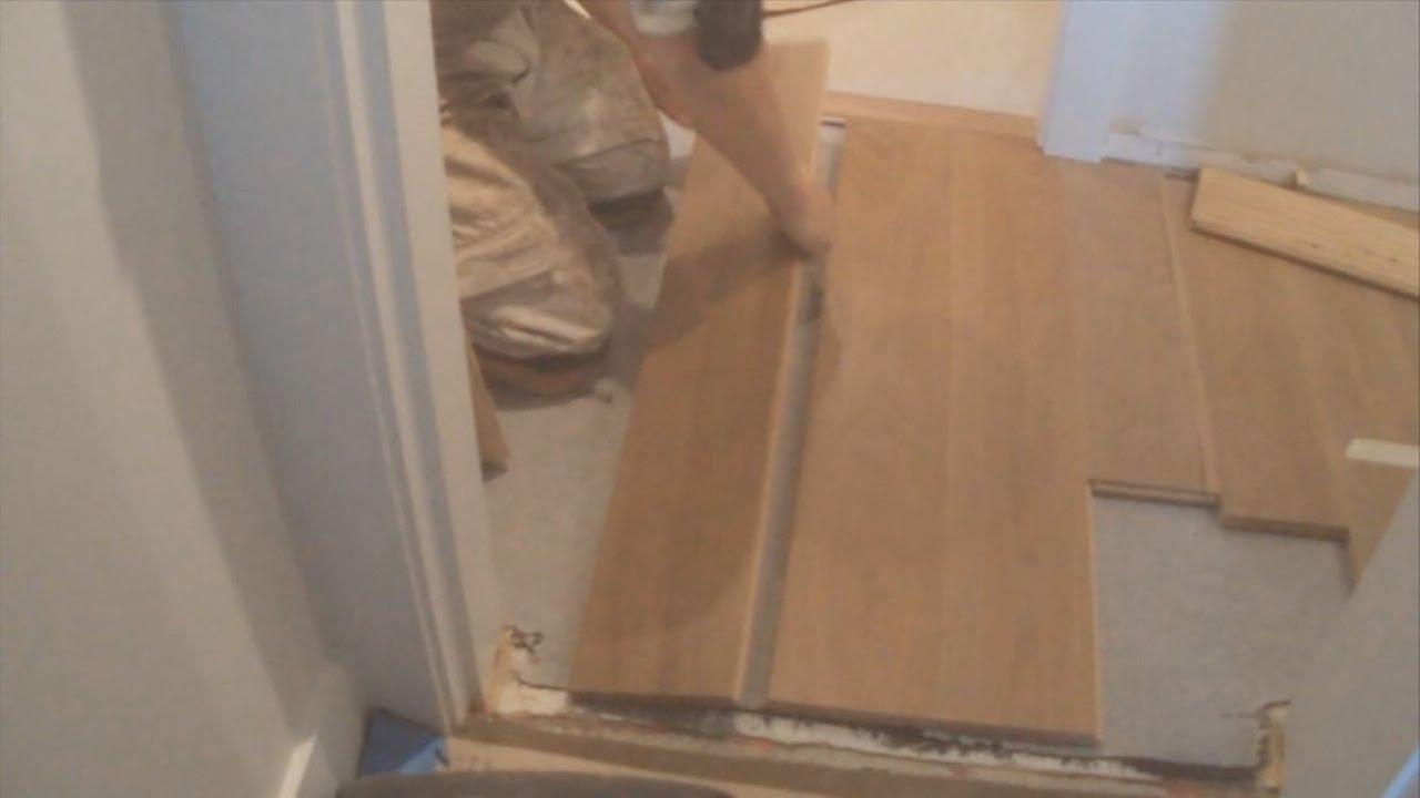How To Installing A Hardwood Floor Glue Down Between Two Rooms In Hallway Mryoucandoityourself You
