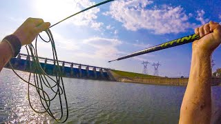SPEAR FISHING A MASSIVE DAM! What LURKS Below This HUGE WALL!? (Hand Thrown Spear)