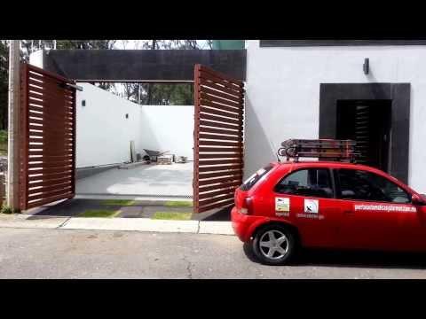 Puertas automaticas de garaje doovi for Brazos puertas automaticas