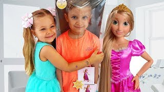 Diana and Roma pretend play with new Rapunzel doll