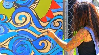 Local artists help students add color to neighborhood
