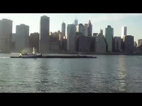 Super Exclusive Catch Of A Tugboat Pushing Two Barges Through NYC Harbor Up The East River