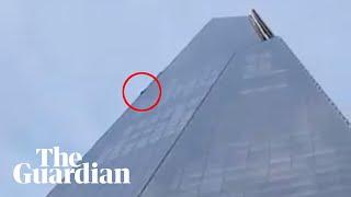 Free climber scales London's Shard skyscraper