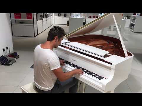 Pianist plays Tango at music store
