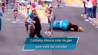 Mujer se cruza inesperadamente por la ruta, atenta a un celular que portaba en su mano derecha. Cuando se percató de que se acercaba el ciclista ya fue tarde