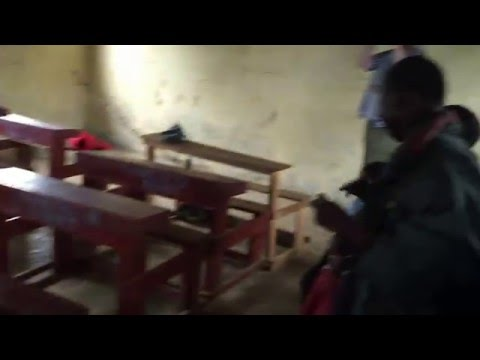Indiana University students leading the singing in a Nakuru slum 1
