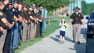 Cops Escort 5-Year-Old Indiana Boy to School After Dad Dies in the Line of Duty thumbnail