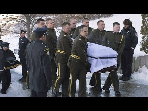 Scenes from outside the funeral for slain Quebec officer