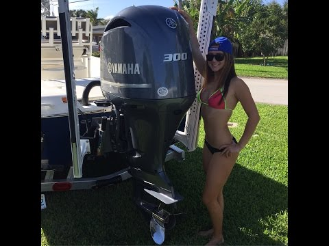 GIRL IN BIKINI CHANGES YAMAHA OUTBOARD ENGINE OIL