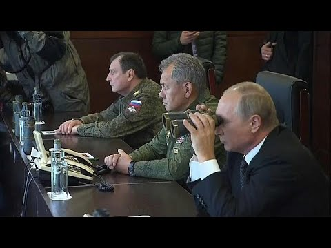 Thumbnail: Vladimir Putin looks on as Russia flexes its military muscles