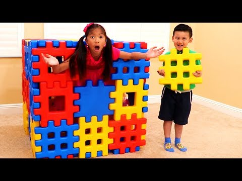 Wendy Pretend Playing with Colored Toy Blocks