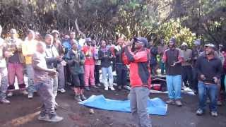 Guides and porters singing after our successful summit of Kilimanjaro