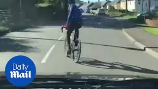 Cyclist weaves in front of van to stop driver overtaking him