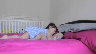 Toddler tickling baby