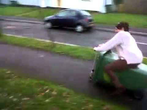 mum riding a wheelie bin down the road!!