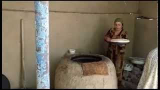 Fotima makes bread in Tajikistan