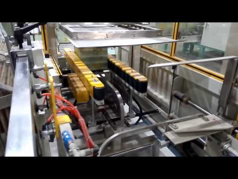 The fully automatic packing machine in rice mill factory