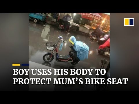 Boy uses his body to protect mum's bike seat in China