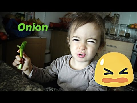 Little Girl Loves Eating Raw Green Onions