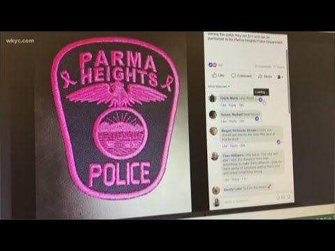 Police officers wearing pink patches for Breast Cancer Awareness month