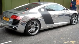 Woman driving flat-tired chrome Audi R8 V8 in London